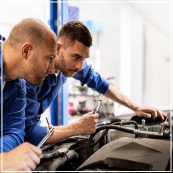 mechanics inspecting an engine
