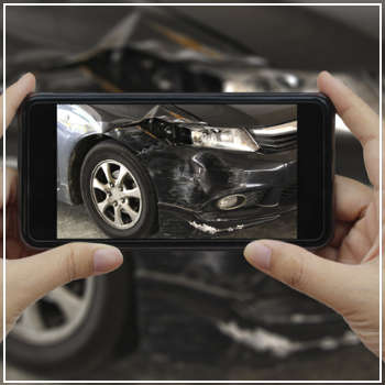 taking photo of car accident damage