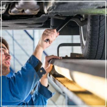 mechanic inspecting suspension