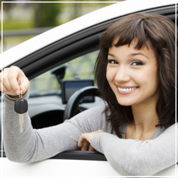 happy young woman holding car keys