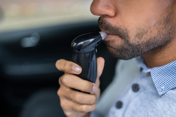 man taking breathalyzer test