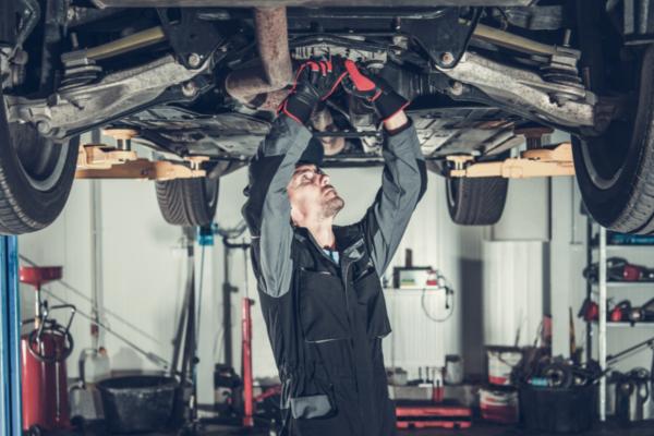 technician inspecting drivetrain