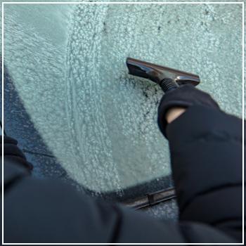 using ice scraper