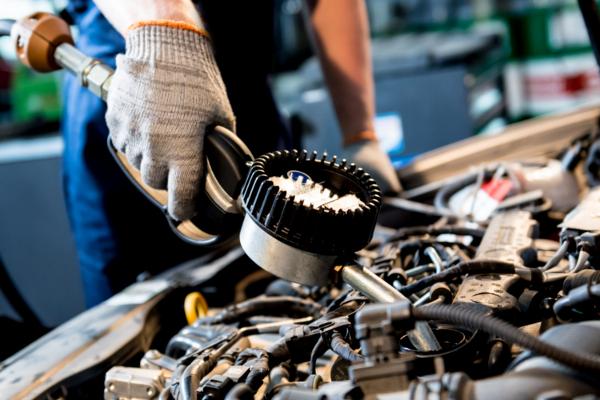 mechanic checking engine oil